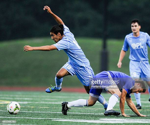 Seacoast United player Sofiane Tergou jumps over Portland Phoenix player Robby Lentine during the PDL Soccer Playoffs at Yarmouth High School in...