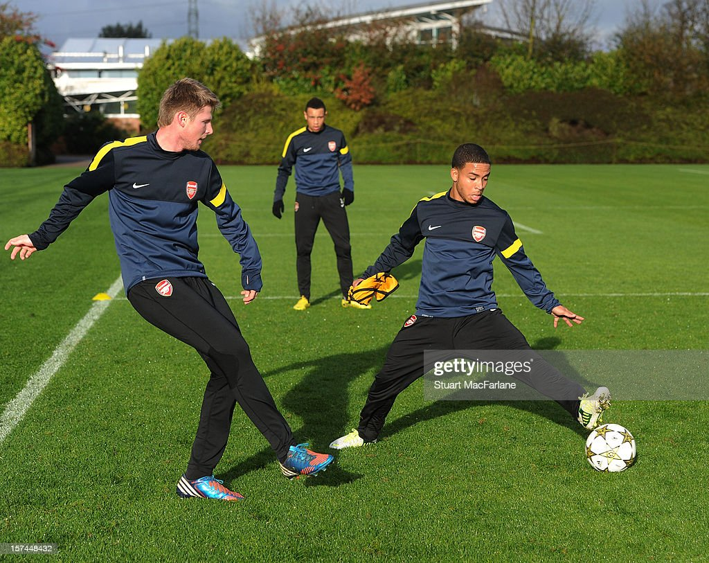 Sead Hajrovic and Jernade Meade of Arsenal during a training session at London Colney on December 03, 2012 in St Albans, England.