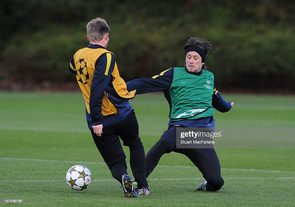 Sead Hajrovic and Tomas Rosicky of Arsenal during a training session at London Colney on December 03, 2012 in St Albans, England.