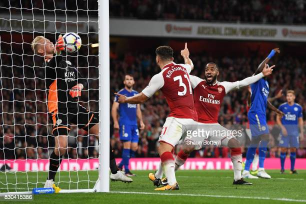 Sead Kolasinac and Alexandre Lacazette of Arsenal celebrate as teammate Olivier Giroud of Arsenal scores their team's fouth goal during the Premier...