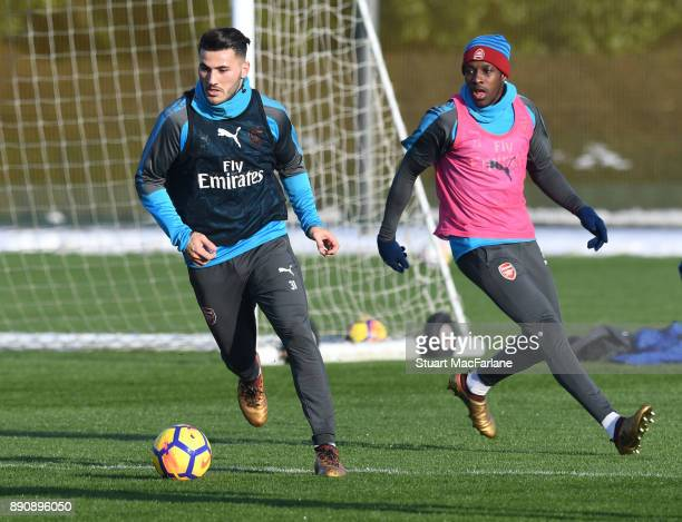 Sead Kolasinac and Danny Welbeck of Arsenal during a training session at London Colney on December 12 2017 in St Albans England