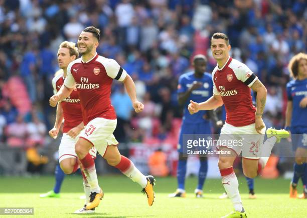 Sead Kolasinac and Granit Xhaka celebrate Arsenal's win after the FA Community Shield match between Chelsea and Arsenal at Wembley Stadium on August...