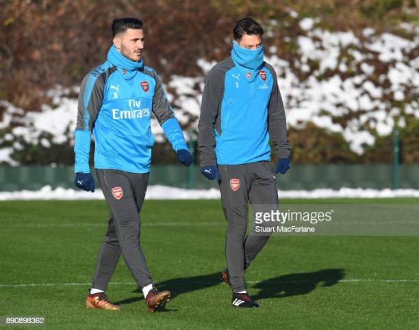 Sead Kolasinac and Mesut Ozil of Arsenal during a training session at London Colney on December 12 2017 in St Albans England