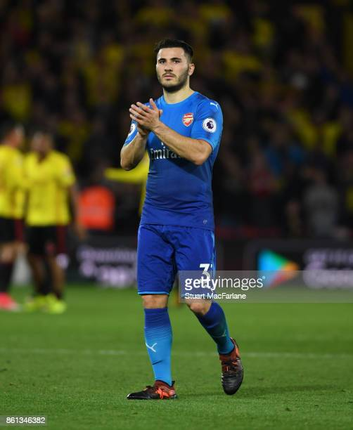 Sead Kolasinac applauds the Arsenal fans after the Premier League match between Watford and Arsenal at Vicarage Road on October 14 2017 in Watford...
