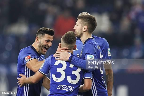 Sead Kolasinac Donis Avdijaj and Guido Burgstaller of Schalke celebrate after winning the Bundesliga match with 10 between FC Schalke 04 and FC...