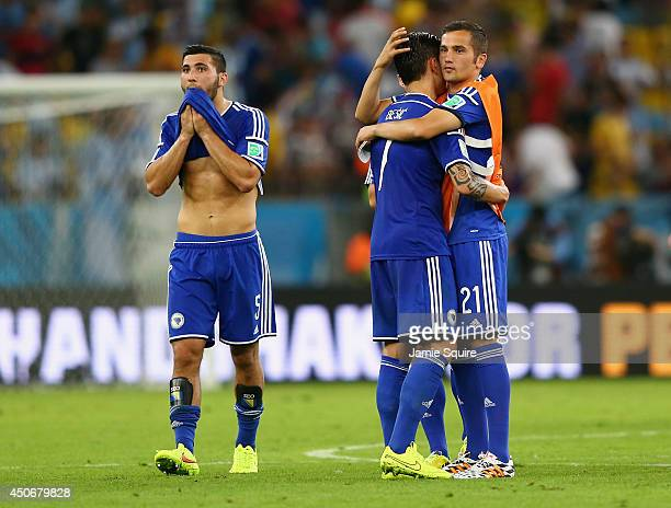 Sead Kolasinac Muhamed Besic and Anel Hadzic of Bosnia and Herzegovina react after losing to Argentina 21 during the 2014 FIFA World Cup Brazil Group...