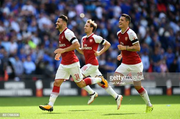 Sead Kolasinac Nacho Monreal and Granit Xhaka of Arsenal celebrate victory during the FA Community Shield between Chelsea and Arsenal at Wembley...