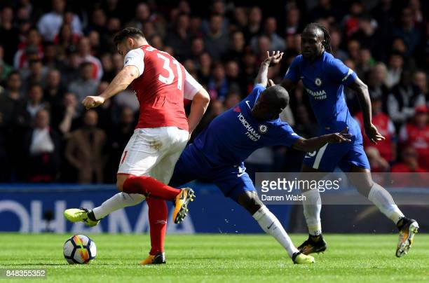Sead Kolasinac of Arsenal and N'Golo Kante of Chelsea battle for possession during the Premier League match between Chelsea and Arsenal at Stamford...