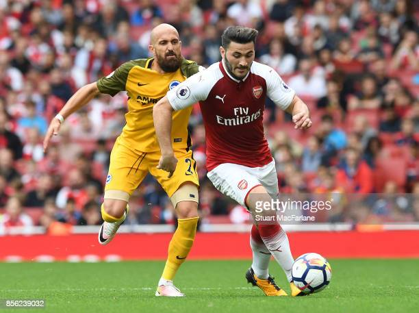 Sead Kolasinac of Arsenal breaks past Bruno Saltor of Brighton during the Premier League match between Arsenal and Brighton and Hove Albion at...