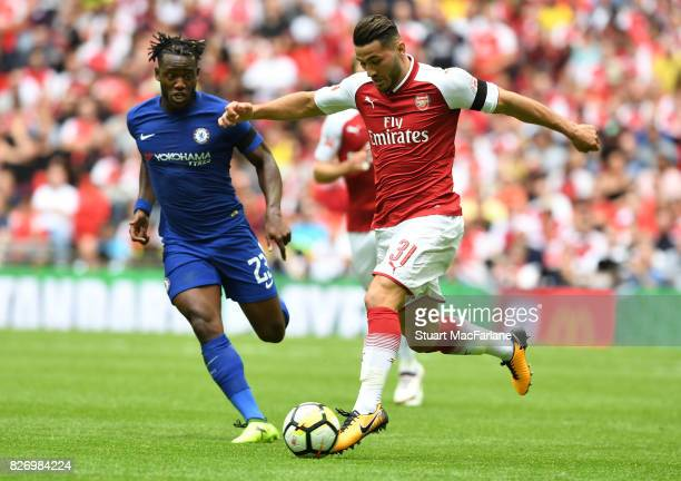 Sead Kolasinac of Arsenal breaks past Michy Batshuayi of Chelsea during the FA Community Shield match between Chelsea and Arsenal at Wembley Stadium...