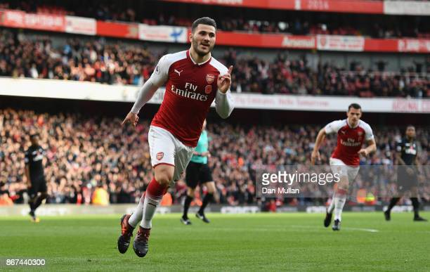 Sead Kolasinac of Arsenal celebrates scoring his sides first goal during the Premier League match between Arsenal and Swansea City at Emirates...