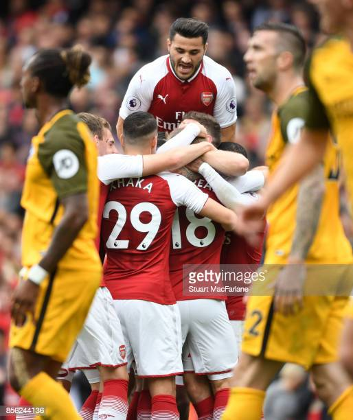 Sead Kolasinac of Arsenal celebrates the first Arsenal goal scored by teammate Nacho Monreal during the Premier League match between Arsenal and...