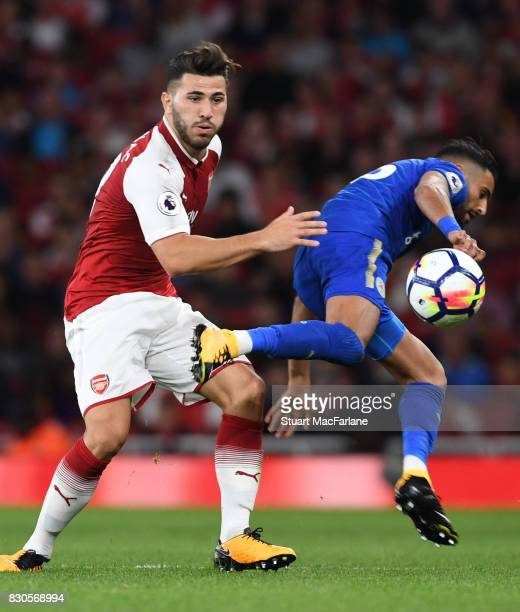 Sead Kolasinac of Arsenal challeges Riyad Mahrez of Leicester during the Premier League match between Arsenal and Leicester City at Emirates Stadium...