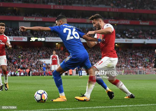 Sead Kolasinac of Arsenal challenges Riyad Mahrez of Leicester during the Premier League match between Arsenal and Leicester City at Emirates Stadium...