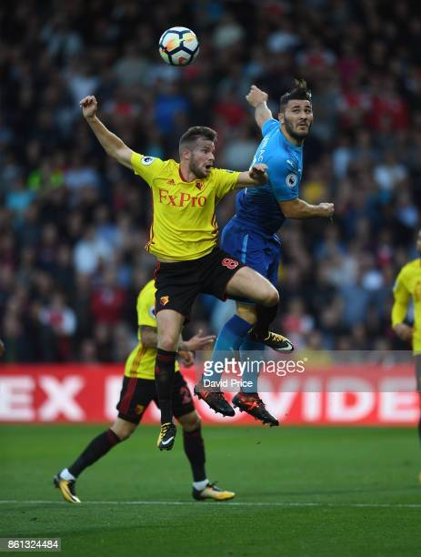 Sead Kolasinac of Arsenal heads the ball under pressure from Tom Cleverley of Watford during the Premier League match between Watford and Arsenal at...