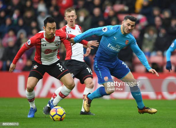 Sead Kolasinac of Arsenal is challenged by Maya Yoshida of Southampton during the Premier League match between Southampton and Arsenal at St Mary's...