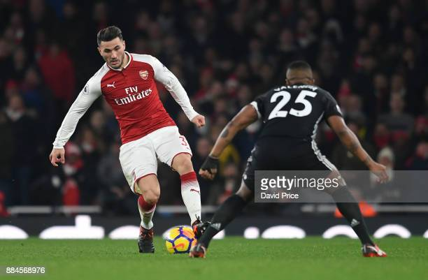 Sead Kolasinac of Arsenal is closed down by Antonio Valencia of Man Utd during the Premier League match between Arsenal and Manchester United at...