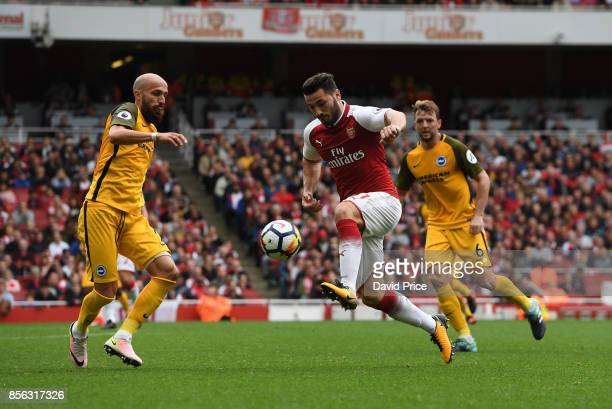 Sead Kolasinac of Arsenal takes on Bruno Saltor of Brighton during the Premier League match between Arsenal and Brighton and Hove Albion at Emirates...