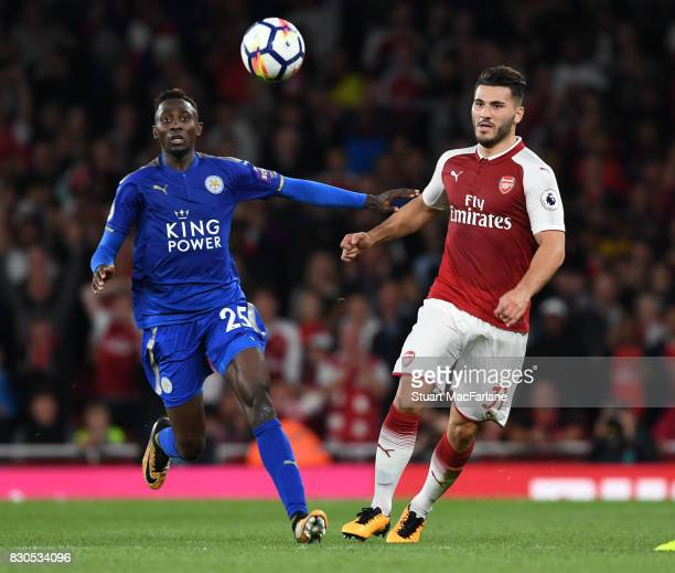 Sead Kolasinac of Arsenal takes on Wilfred Ndidi of Leciester during the Premier League match between Arsenal and Leicester City at Emirates Stadium...