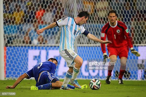 Sead Kolasinac of Bosnia and Herzegovina and Lionel Messi of Argentina