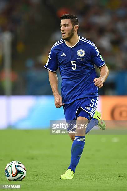 Sead Kolasinac of Bosnia and Herzegovina controls the ball during the 2014 FIFA World Cup Brazil Group F match between Argentina and...
