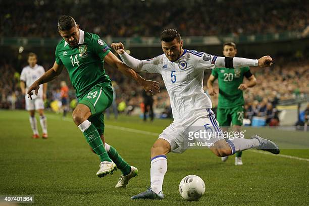 Sead Kolasinac of Bosnia and Herzegovina crosses the ball under pressure from Jon Walters of the Republic of Ireland during the UEFA EURO 2016...