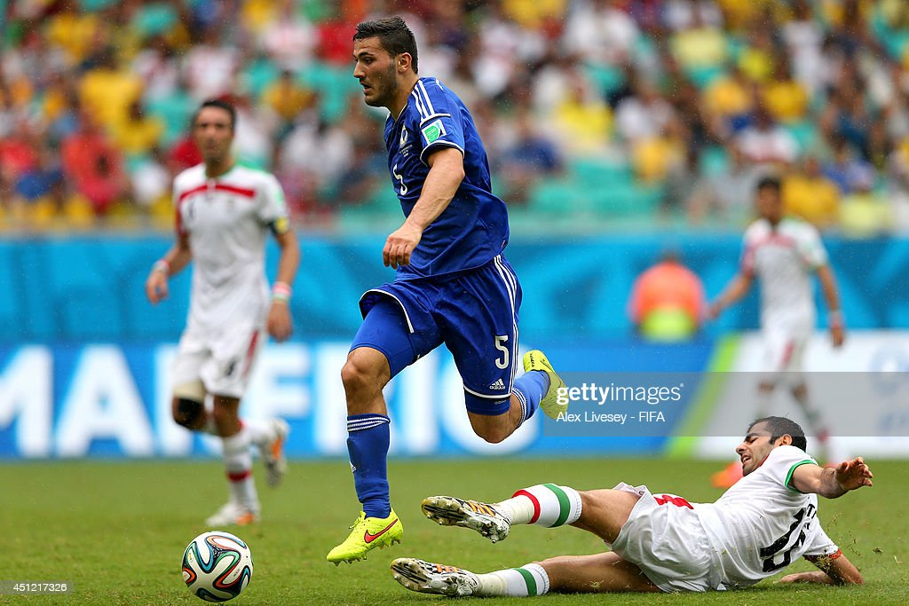 Sead Kolasinac of Bosnia and Herzegovina is tackled by <a gi-track='captionPersonalityLinkClicked' href=/galleries/search?phrase=Pejman+Montazeri&family=editorial&specificpeople=4074746 ng-click='$event.stopPropagation()'>Pejman Montazeri</a> of Iran during the 2014 FIFA World Cup Brazil Group F match between Bosnia-Herzegovina and Iran at Arena Fonte Nova on June 25, 2014 in Salvador, Brazil.