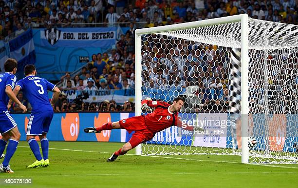 Sead Kolasinac of Bosnia and Herzegovina scores an own goal during the 2014 FIFA World Cup Brazil Group F match between Argentina and...