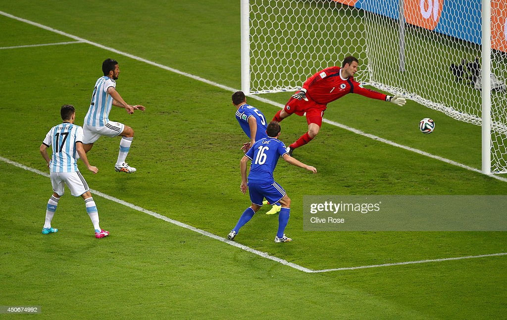 Sead Kolasinac of Bosnia and Herzegovina scores an own goal past goalkeeper <a gi-track='captionPersonalityLinkClicked' href=/galleries/search?phrase=Asmir+Begovic&family=editorial&specificpeople=4184467 ng-click='$event.stopPropagation()'>Asmir Begovic</a> as <a gi-track='captionPersonalityLinkClicked' href=/galleries/search?phrase=Ezequiel+Garay&family=editorial&specificpeople=857797 ng-click='$event.stopPropagation()'>Ezequiel Garay</a> and Federico Fernandez of Argentina look on during the 2014 FIFA World Cup Brazil Group F match between Argentina and Bosnia-Herzegovina at Maracana on June 15, 2014 in Rio de Janeiro, Brazil.