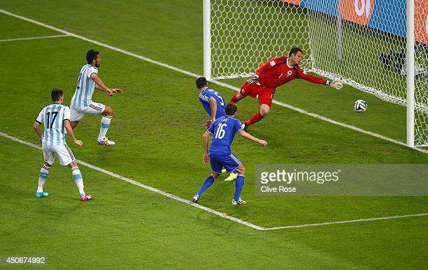 Sead Kolasinac of Bosnia and Herzegovina scores an own goal past goalkeeper Asmir Begovic as Ezequiel Garay and Federico Fernandez of Argentina look...