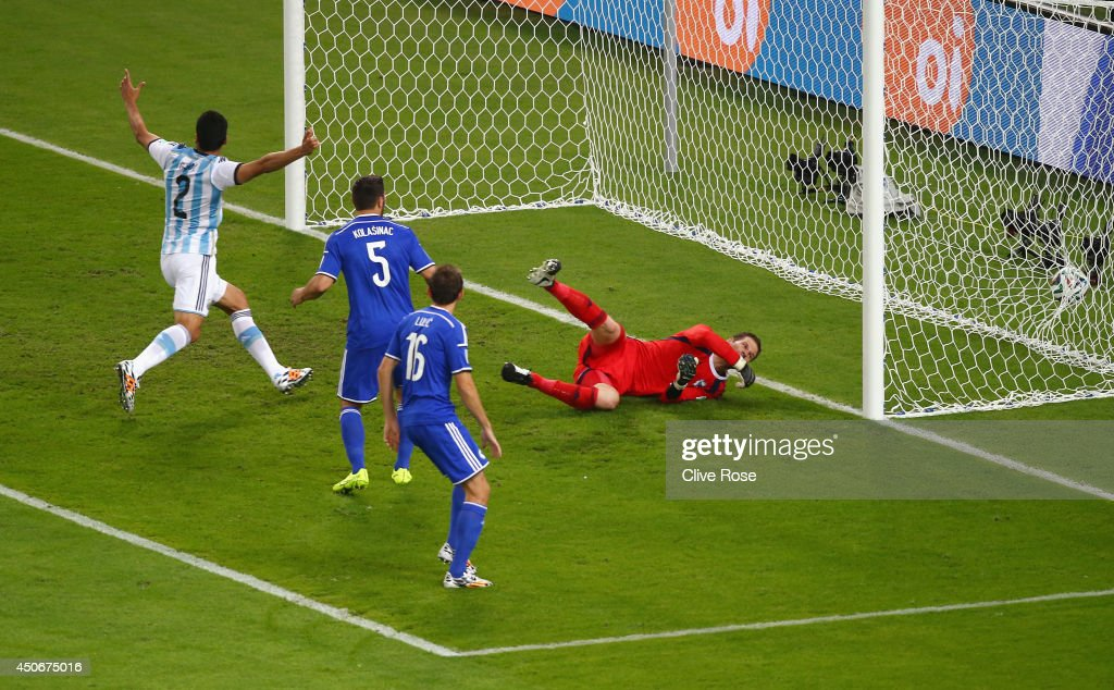 Sead Kolasinac of Bosnia and Herzegovina scores an own goal past goalkeeper <a gi-track='captionPersonalityLinkClicked' href=/galleries/search?phrase=Asmir+Begovic&family=editorial&specificpeople=4184467 ng-click='$event.stopPropagation()'>Asmir Begovic</a> as <a gi-track='captionPersonalityLinkClicked' href=/galleries/search?phrase=Ezequiel+Garay&family=editorial&specificpeople=857797 ng-click='$event.stopPropagation()'>Ezequiel Garay</a> of Argentina celebrates during the 2014 FIFA World Cup Brazil Group F match between Argentina and Bosnia-Herzegovina at Maracana on June 15, 2014 in Rio de Janeiro, Brazil.