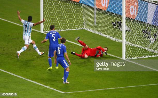 Sead Kolasinac of Bosnia and Herzegovina scores an own goal past goalkeeper Asmir Begovic as Ezequiel Garay of Argentina celebrates during the 2014...