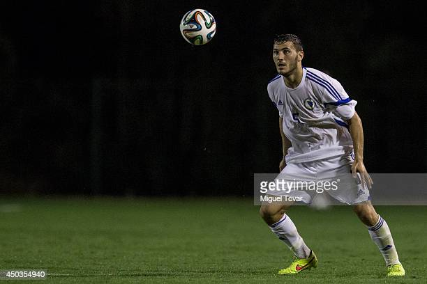 Sead Kolasinac of Bosnia drives the ball during a training session match against a Santos FC U20 team at Municipal Antonio Fernandes Stadium on June...