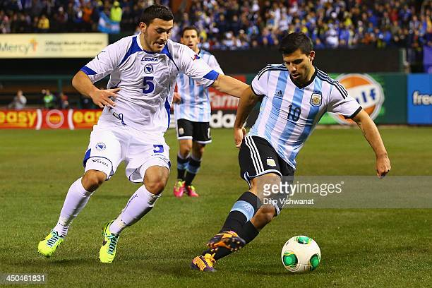 Sead Kolasinac of BosniaHerzegovina defends against Sergio Aguero of Argentina during the international friendly match between BosniaHerzegovina and...