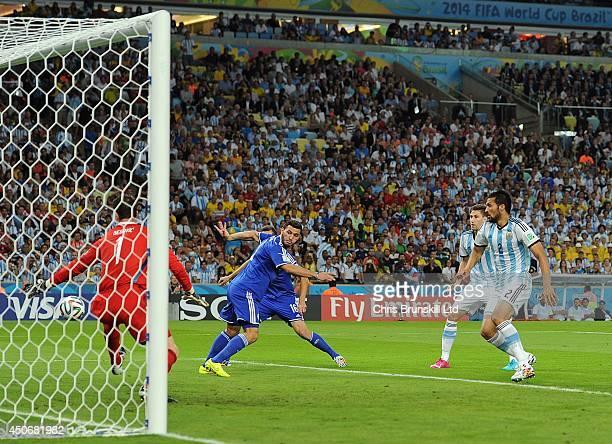 Sead Kolasinac of BosniaHerzegovina scores a goal during the 2014 FIFA World Cup Brazil Group F match between Argentina and BosniaHerzegovina at...