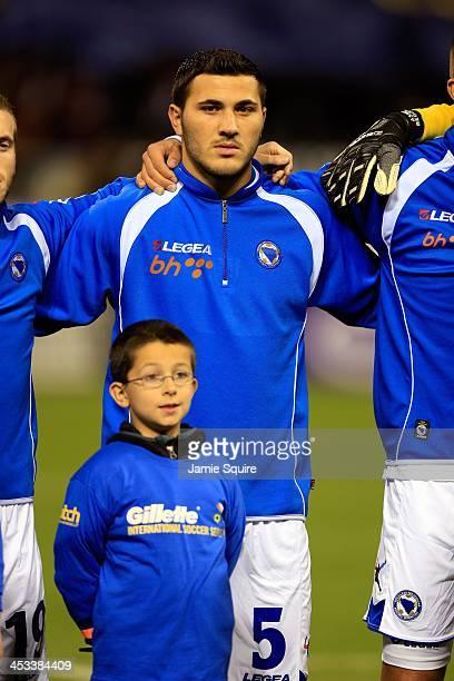 Sead Kolasinac of BosniaHerzegovina stands during the national anthem of BosniaHerzegovina prior to the international friendly match against...
