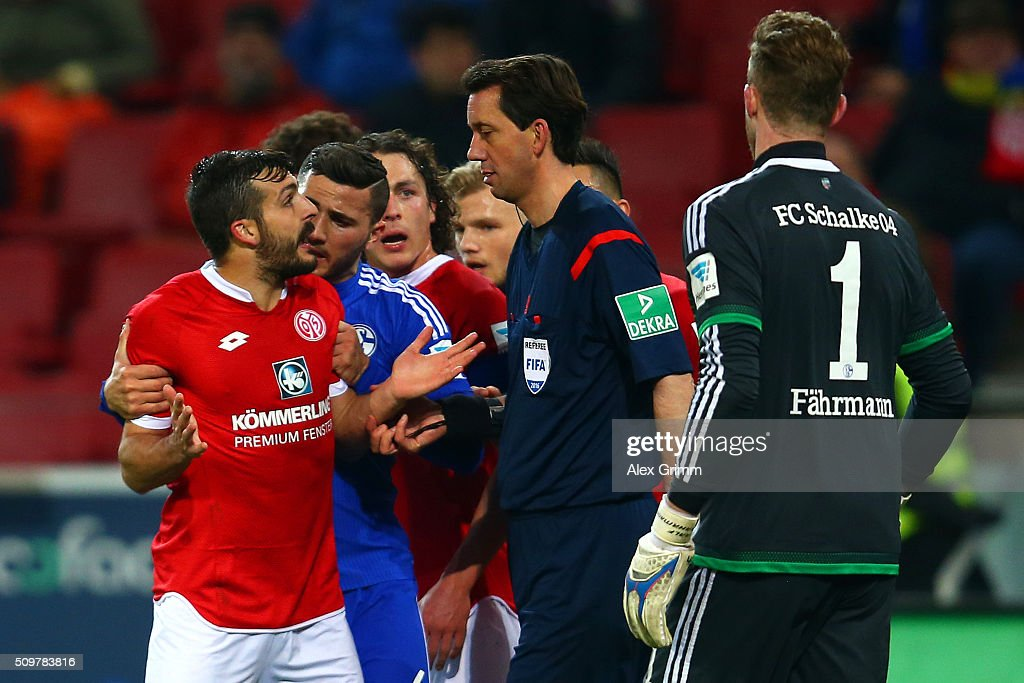 Sead Kolasinac of FC Schalke 04 restrains Giulio Donati of 1. FSV Mainz 05 as he argues with referee Manuel Grafe during the Bundesliga match between 1. FSV Mainz 05 and FC Schalke 04 at Coface Arena on February 12, 2016 in Mainz, Germany.