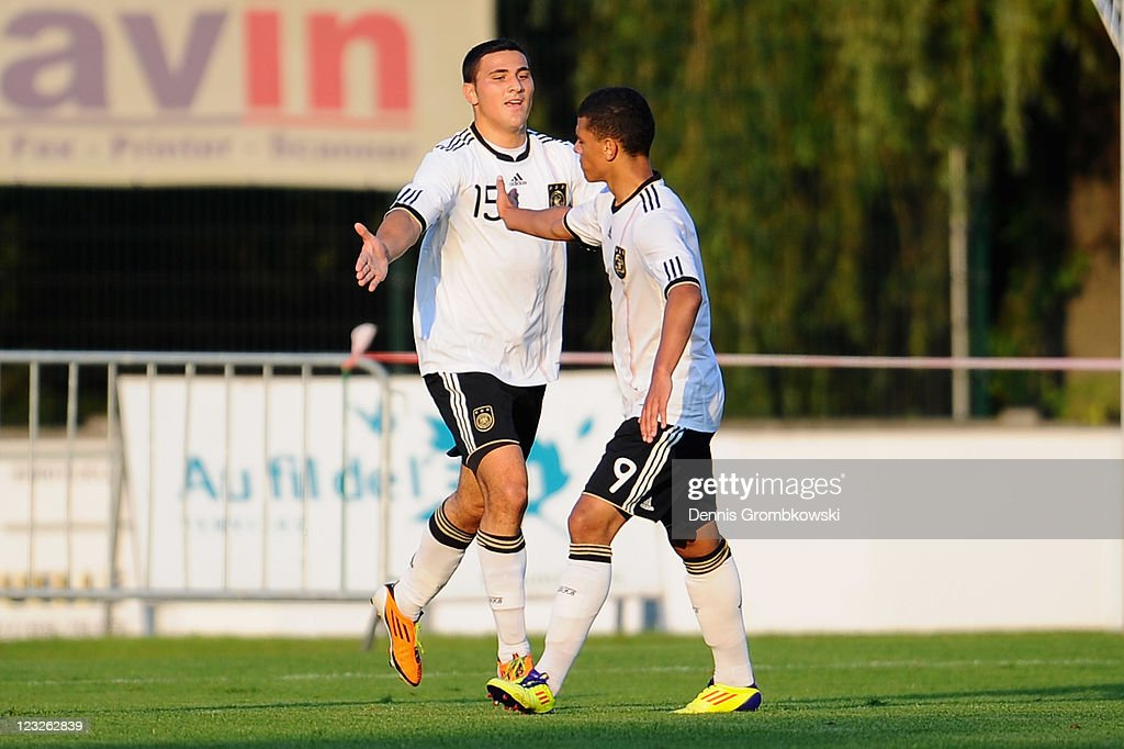 Sead Kolasinac (L) of Germany celebrates with team mate <a gi-track='captionPersonalityLinkClicked' href=/galleries/search?phrase=Shawn+Parker+-+Soccer+Player&family=editorial&specificpeople=5385069 ng-click='$event.stopPropagation()'>Shawn Parker</a> (R) after scoring his team's second goal during the U19 International friendly match between Belgium and Germany at Stade Bielmont on September 1, 2011 in Verviers, Belgium.