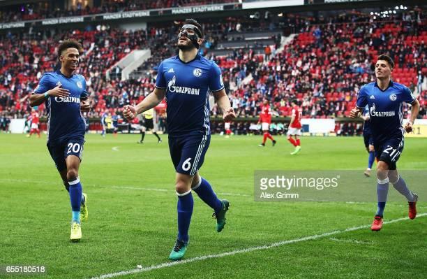 Sead Kolasinac of Schalke 04 is congratulated by Thilo Kehrer of Schalke 04 after scoring a goal during the Bundesliga match between 1 FSV Mainz 05...
