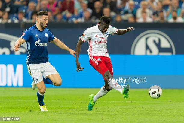 Sead Kolasinac of Schalke and Bakery Jatta of Hamburg battle for the ball during to the Bundesliga match between FC Schalke 04 and Hamburger SV at...