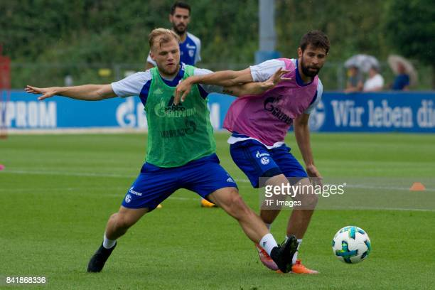 Sead Kolasinac of Schalke and Coke of Schalke battle for the ball during a training session at the FC Schalke 04 Training center on August 30 2017 in...