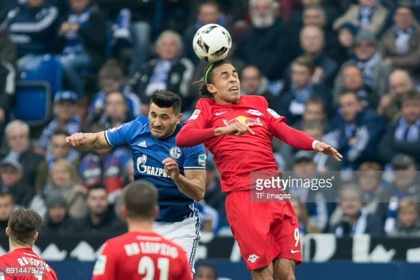 Sead Kolasinac of Schalke and Yussuf Poulsen of Leipzig battle for the ball during the Bundesliga match between FC Schalke 04 and RB Leipzig at...