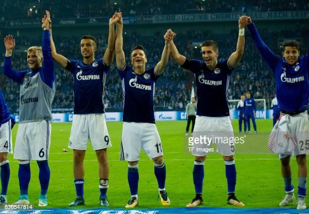 Sead Kolasinac of Schalke Franco Di Santo of Schalke Yevhen Konoplyanka of Schalke and Amine Harit of Schalke celebrate their win during the...