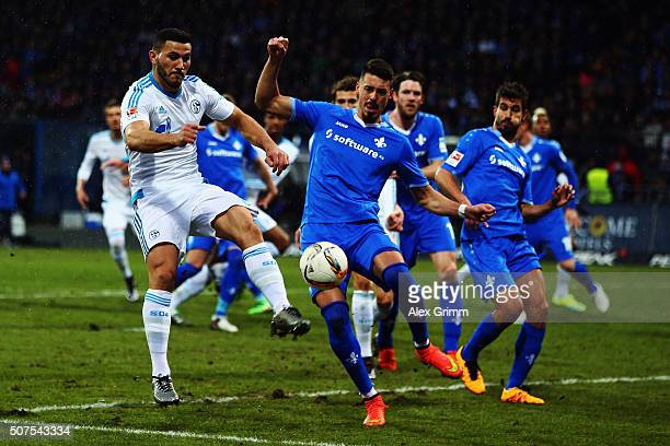 Sead Kolasinac of Schalke is challenged by Sandro Wagner of Darmstadt during the Bundesliga match between SV Darmstadt 98 and FC Schalke 04 at...