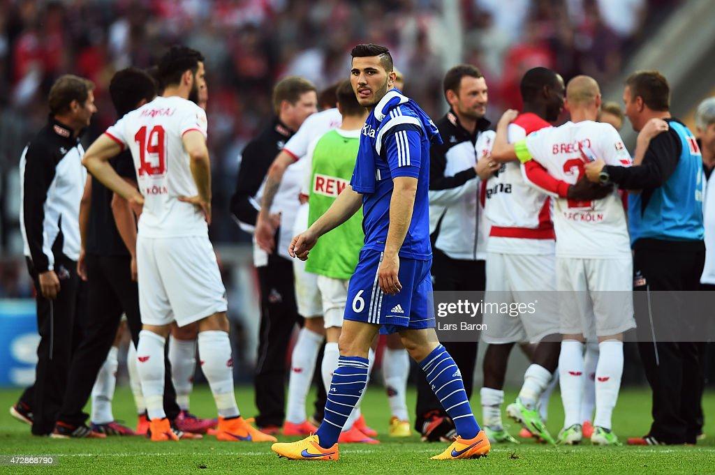 Sead Kolasinac (front) of Schalke reacts as players of Koeln celebrate after the Bundesliga match between 1. FC Koeln and FC Schalke 04 at RheinEnergieStadion on May 10, 2015 in Cologne, Germany.