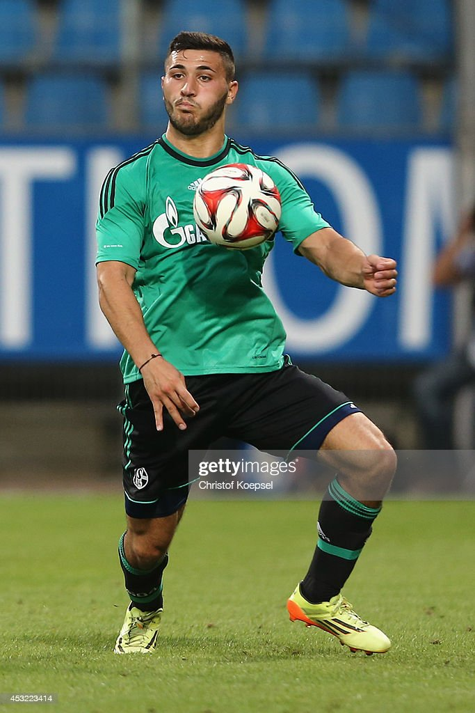 Sead Kolasinac of Schalke runs with the ball during the pre-season friendly match between VfL Bochum and FC Schalke 04 at Rewirpower Stadium on August 5, 2014 in Bochum, Germany.