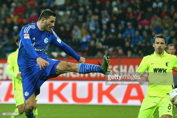 Sead Kolasinac of Schalke scores the first team goal during the Bundesliga match between FC Augsburg and FC Schalke 04 at WWK Arena on December 13...