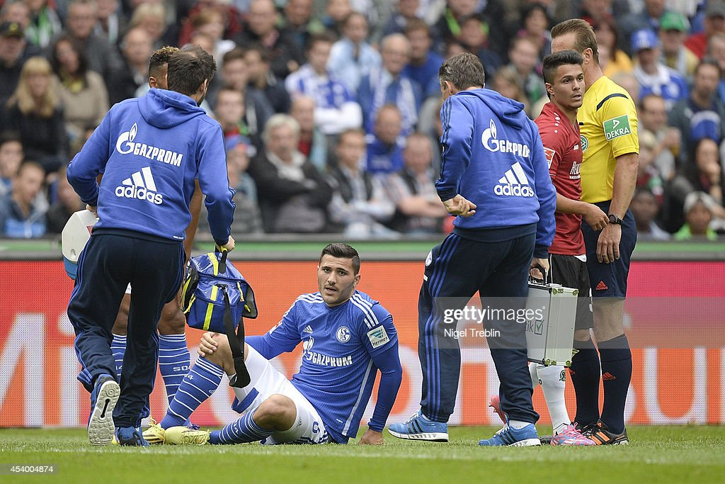 Sead Kolasinac of Schalke sits on the pitch during the Bundesliga match between FC Schalke 04 and Hannover 96 at HDI-Arena on August 23, 2014 in Hanover, Germany.