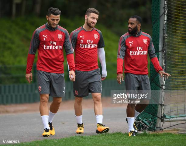 Sead Kolasinac Shkodran Mustafi and Alex Lacazette of Arsenal before a training session at London Colney on August 2 2017 in St Albans England