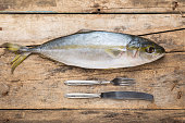Seafood culinary recipe background. Tuna fish on wood table top view image